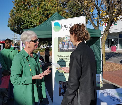 Susan Denny speaking to a woman at the Sale Sunday Charity Variety market